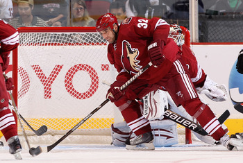 GLENDALE, AZ - JANUARY 22:  Michal Rozsival #32 of the Phoenix Coyotes skates with the puck during the NHL game at Jobing.com Arena on January 22, 2011 in Glendale, Arizona.  The Kings defeated the Coyotes 4-3.  (Photo by Christian Petersen/Getty Images)