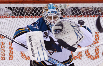 VANCOUVER, CANADA - JANUARY 20: Goalie Antti Niemi #31 of the San Jose Sharks makes a glove save against the Vancouver Canucks during the third period in NHL action on January 20, 2011 at Rogers Arena in Vancouver, BC, Canada.  (Photo by Rich Lam/Getty Im