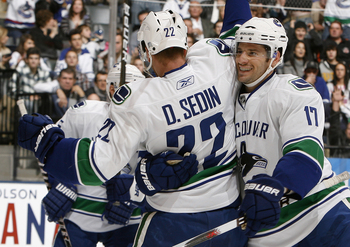 TORONTO - NOVEMBER 13: Daniel Sedin #22 and Ryan Kesler #17 of the Vancouver Canucks celebrate Ryan Kesler goal during game action against the Toronto Maple Leafs at the Air Canada Centre November 13, 2010 in Toronto, Ontario, Canada. (Photo by Abelimages