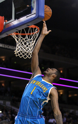OAKLAND, CA - JANUARY 26:  Trevor Ariza #1 of the New Orleans Hornets goes up for a shot during their game against the Golden State Warriors at Oracle Arena on January 26, 2011 in Oakland, California.  NOTE TO USER: User expressly acknowledges and agrees