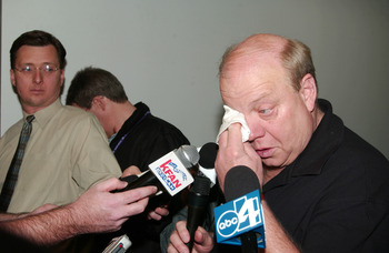 SALT LAKE CITY - MAY 2:  An emotional owner Larry H. Miller of the Utah Jazz wipes away a tear as he speaks to the media following John Stockton's retirement from NBA basketball on May 2, 2003 in Salt Lake City, Utah.  Stockton played 19 seasons with the