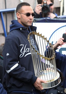 NEW YORK - NOVEMBER 06:  Captain Derek Jeter #2 of the New York Yankees celebrates with the championship trophy during the New York Yankees World Series Victory Celebration at City Hall on November 6, 2009 in New York, New York.  (Photo by Jim McIsaac/Get