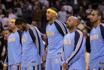 PHOENIX - APRIL 13:  Carmelo Anthony #15 of the Denver Nuggets stands with teammates before the NBA game against the Phoenix Suns at US Airways Center on April 13, 2010 in Phoenix, Arizona. The Suns defeated the Nuggets 123-101.  NOTE TO USER: User expres