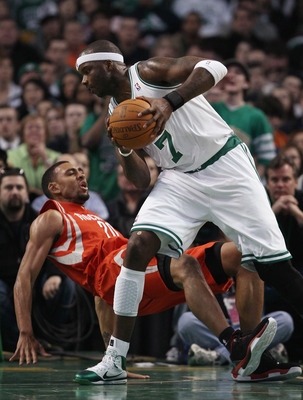 BOSTON, MA - JANUARY 10:  Jermaine O'Neal #7 of the Boston Celtics heads for the basket as Jared Jeffries #20 of the Houston Rockets falls to the ground on January 10, 2011 at the TD Garden in Boston, Massachusetts.  The Rockets defeated the Celtics 108-1