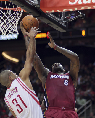 HOUSTON - DECEMBER 29:  LeBron James #6 of the Miami Heat drives to the basket over Houston Rockets' Shane Battier #31 in the first half at Toyota Center on December 29, 2010 in Houston, Texas.  NOTE TO USER: User expressly acknowledges and agrees that, b