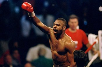 25 Apr 1998:  Roy Jones Jr. celebrates his bout against Virgil Hill at the Coast Coliseum in Biloxi, Mississippi. Mandatory Credit: Stephen Dunn  /Allsport
