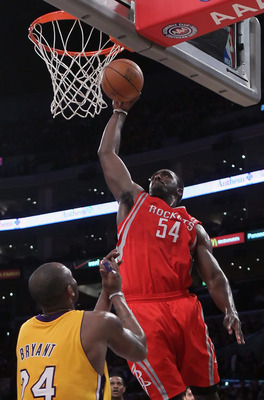 LOS ANGELES, CA - FEBRUARY 01:  Patrick Patterson #54 of the Houston Rockets drives over Kobe Bryant #24 of the Los Angeles Lakers for a dunk in the first half at Staples Center on February 1, 2011 in Los Angeles, California. NOTE TO USER: User expressly