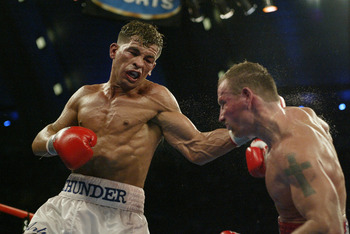 ATLANTIC CITY, NJ - JUNE 7:  Arturo Gatti lands a left hook to Micky Ward during their Junior Welterweight bout at Boardwalk Hall on June 7, 2003 in Atlantic City, New Jersey. Gatti won a unanimous decision. (Photo by Al Bello/Getty Images)
