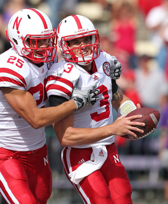 SEATTLE - SEPTEMBER 18:  Quarterback Taylor Martinez #3 of the Nebraska Cornhuskers celebrates with Kyler Reed #25 after scoring on an 80 yard touchdown run in the third quarter against the Washington Huskies on September 18, 2010 at Husky Stadium in Seat
