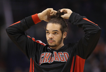 PHOENIX - NOVEMBER 24:  Joakim Noah #13 of the Chicago Bulls warms up before the NBA game against the Phoenix Suns at US Airways Center on November 24, 2010 in Phoenix, Arizona. The Bulls defeated the Suns 123-115 in double overtime.  NOTE TO USER: User e