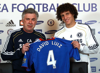 COBHAM, ENGLAND - FEBRUARY 11:  David Luiz of Chelsea is presented his shirt by Chelsea manager Carlo Ancelotti during a press conference at the Cobham training ground on February 11, 2011 in Cobham, England.  (Photo by Warren Little/Getty Images)