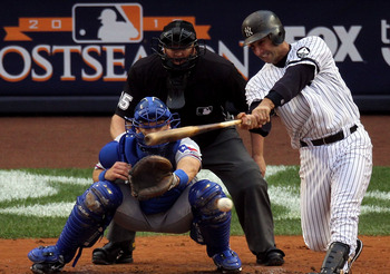 NEW YORK - OCTOBER 20:  Jorge Posada #20 of the New York Yankees hits a RBI single in the bottom of the second inning against the Texas Rangers in Game Five of the ALCS during the 2010 MLB Playoffs at Yankee Stadium on October 20, 2010 in the Bronx boroug