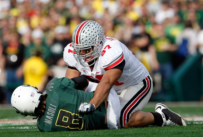 PASADENA, CA - JANUARY 01:  Defensive lineman Cameron Heyward #97 of the Ohio State Buckeyes sacks quarterback Jeremiah Masoli #8 of the Oregon Ducks during the 96th Rose Bowl game on January 1, 2010 in Pasadena, California.  (Photo by Jeff Gross/Getty Im