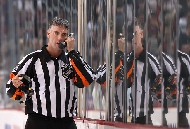GLENDALE, AZ - JANUARY 22:  Referee Dean Morton #36 talks on the phone during the NHL game between the Los Angeles Kings and the Phoenix Coyotes at Jobing.com Arena on January 22, 2011 in Glendale, Arizona.  The Kings defeated the Coyotes 4-3.  (Photo by