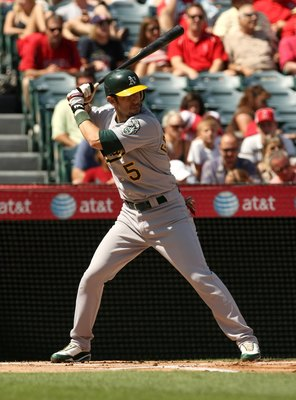 ANAHEIM, CA - SEPTEMBER 27:  Nomar Garciaparra #5 of the Oakland Athletics bats against the Los Angeles Angels of Anaheim on September 27, 2009 at Angel Stadium in Anaheim, California.   The Angels won 7-4.  (Photo by Stephen Dunn/Getty Images)