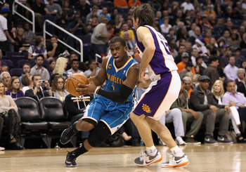 PHOENIX, AZ - JANUARY 30:  Chris Paul #3 of the New Orleans Hornets drives the ball against Steve Nash #13 of the Phoenix Suns during the NBA game at US Airways Center on January 30, 2011 in Phoenix, Arizona.  NOTE TO USER: User expressly acknowledges and