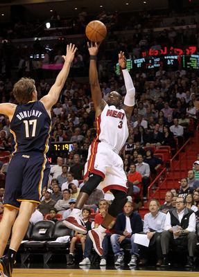 MIAMI, FL - FEBRUARY 08:  Dwyane Wade #3 of the Miami Heat shoots a jumper over Mike Dunleavy #17 of the Indiana Pacers during a game at American Airlines Arena on February 8, 2011 in Miami, Florida. NOTE TO USER: User expressly acknowledges and agrees th