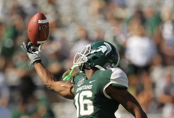 ORLANDO, FL - JANUARY 01:  Chris Rucker #16 of the Michigan State Spartans warms up during the Capitol One Bowl against the Alabama Crimson Tide at the Florida Citrus Bowl on January 1, 2011 in Orlando, Florida.  (Photo by Mike Ehrmann/Getty Images)