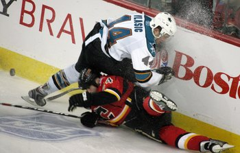 CALGARY, CANADA - APRIL 20: Craig Conroy #24 of the Calgary Flames can't beat Marc-Edouard Vlasic #44 of the San Jose Sharks to the puck for an icing call during Game 6 of the 2008 NHL Stanley Cup Playoffs Western Conference Quarterfinals at Pengrowth Sad