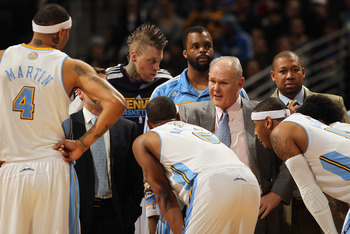 DENVER, CO - FEBRUARY 10:  Head coach George Karl of the Denver Nuggets directs his team during a time out against the Dallas Mavericks during NBA action at the Pepsi Center on February 10, 2011 in Denver, Colorado. The Nuggets defeated the Mavericks 121-