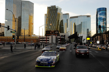 LAS VEGAS, NV - DECEMBER 02:  NASCAR driver Jimmie Johnson leads cars during the NASCAR Victory Lap through the streets of Las Vegas on December 2, 2010 in Las Vegas, Nevada.  (Photo by Rusty Jarrett/Getty Images for NASCAR)