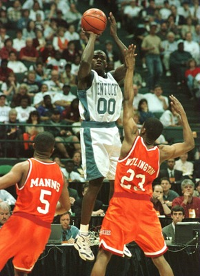 16 Mar 1996:  Tony Delk #00 of Kentucky puts up a shot over Troy Manns #5 and Damon Wallington #23 of Virginia Tech during the second round of the NCAA Midwest Regional Men''s Basketball Tournament played at Renunion Arena in Dallas, Texas. Kentucky defea