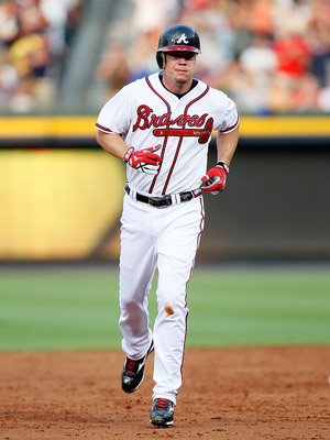 ATLANTA - JULY 15:  Chipper Jones #10 of the Atlanta Braves trotts to third base after hitting a solo homer in the third inning against the Milwaukee Brewers at Turner Field on July 15, 2010 in Atlanta, Georgia.  (Photo by Kevin C. Cox/Getty Images)