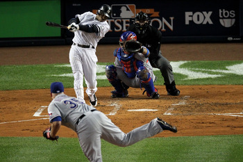 NEW YORK - OCTOBER 19:  Robinson Cano #24 of the New York Yankees hits a solo homr run in the bottom of the second inning against the Texas Rangers in Game Four of the ALCS during the 2010 MLB Playoffs at Yankee Stadium on October 19, 2010 in the Bronx bo