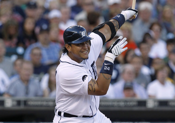 DETROIT - JULY 09:  Miguel Cabrera #24 of the Detroit Tigers hits a sacrifice fly in the second inning scoring Ryan Raburn  during the game against the Minnesota Twins on July 9, 2010 at Comerica Park in Detroit, Michigan. The Tigers defeated the Twins 7-