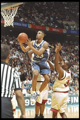 30 Mar 1996:  Guard Ron Mercer of the Kentucky Wildcats goes up for two against Dana Dingel of the Massachusetts Minutemen during a game at the Meadowlands in East Rutherford, New Jersey.  Kentucky won the game, 81-74. Mandatory Credit: Doug Pensinger/All
