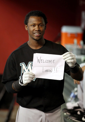 PHOENIX - JULY 08:  Hanley Ramirez #2 of the Florida Marlins holds up a 'Welcome LeBron' sign for television and phototographers in the dugout before before the Major League Baseball game against the Arizona Diamondbacks at Chase Field on July 8, 2010 in