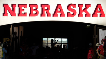 LINCOLN, NE - OCTOBER 30: The Husker faithful cheer the Nebraska Cornhusker football team before ttaking the field against the Missouri Tigers at Memorial Stadium on October 30, 2010 in Lincoln, Nebraska. Nebraska Defeated Missouri 31-17. (Photo by Eric F