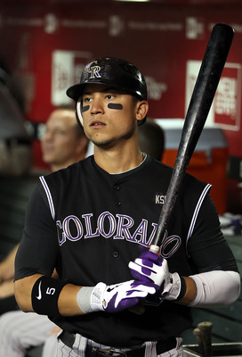 PHOENIX - SEPTEMBER 21:  Carlos Gonzalez #5 of the Colorado Rockies looks on from the dugout during the Major League Baseball game against the Arizona Diamondbacks at Chase Field on September 21, 2010 in Phoenix, Arizona.  (Photo by Christian Petersen/Get
