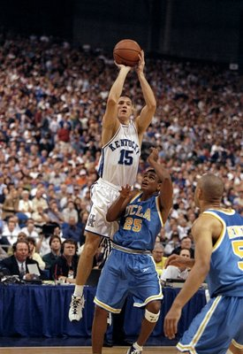 20 Mar 1998:  Guard Jeff Sheppard of the Kentucky Wildcats in action against guard Earl Watson of the UCLA Bruins during an NCAA Regional Semifinals game at Tropicana Field in St. Petersburg, Florida.  Kentucky defeated UCLA 94-68. Mandatory Credit: Andy