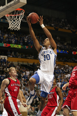 NASHVILLE, TN - MARCH 23:  Keith Bogans #10 of Kentucky drives to the net for two as Bryant Markson #20 and Trace Caton #21 of Utah look on during the second round of the NCAA Mens Basketball Championship on March 23, 2003 at the Gaylord Entertainment Cen
