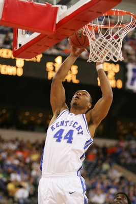 INDIANAPOLIS - MARCH 17:  Chuck Hayes #44 of the Kentucky Wildcats attempts a shot under the basket against the Eastern Kentucky Colonels in the first round game of the NCAA Division I Men's Basketball Tournament March 17, 2005 at RCA Dome in Indianapolis