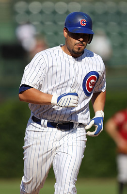 CHICAGO - JULY 21: Geovany Soto #18 of the Chicago Cubs runs the bases after hitting a two-run home run in the 11th inning against the Houston Astros at Wrigley Field on July 21, 2010 in Chicago, Illinois. The Astros defeated the Cubs 4-3 in 12 innings. (