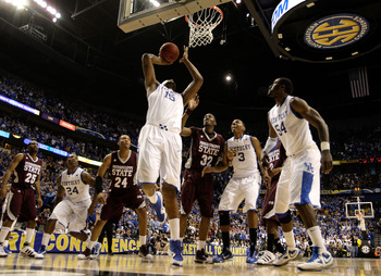 NASHVILLE, TN - MARCH 14:  DeMarcus Cousins #15 of the Kentucky Wildcats makes a 2-point basket at the end of regulatio to tie the game and send it into overtime  against Jarvis Varnado #32 of the Mississippi State Bulldogs during the final of the SEC Men