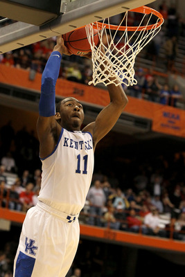 SYRACUSE, NY - MARCH 25:  John Wall #11 of the Kentucky Wildcats dunks in the second half against the Cornell Big Red during the east regional semifinal of the 2010 NCAA men's basketball tournament at the Carrier Dome on March 25, 2010 in Syracuse, New Yo