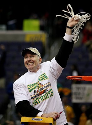 WASHINGTON - MARCH 26:  Head coach Jim Larranaga of the George Mason Patriots celebrate their win over the Connecticut Huskies during the Regional Finals of the NCAA Men's Basketball Tournament on March 26, 2006 at the Verizon Center in Washington DC. The