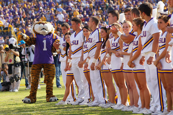 BATON ROUGE, LA - NOVEMBER 20:  Mike the Tiger and the cheerleaders of the Louisiana State University Tigers cheer before facing the Ole Miss Rebels at Tiger Stadium on November 20, 2010 in Baton Rouge, Louisiana.  (Photo by Kevin C. Cox/Getty Images)