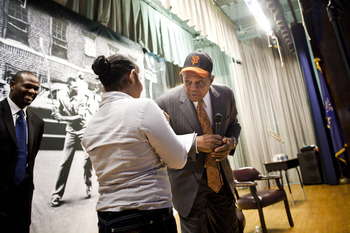 NEW YORK - JANURARY 21:  Willie Mays, right, answers questions from students during a visit to PS 46 in Harlem, next to the site of the former Polo Grounds, where the new York Giants played before moving to San Francisco in 1958, on Jan. 21, 2011 in New Y