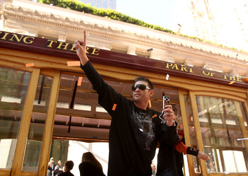 SAN FRANCISCO - NOVEMBER 03:  Freddy Sanchez of the San Francisco Giants waves to the crowd during the San Francisco Giants victory parade on November 3, 2010 in San Francisco, California.  (Photo by Ezra Shaw/Getty Images)