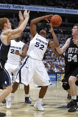 CINCINNATI, OH - DECEMBER 9: Tu Holloway #52 of the Xavier Musketeers has the ball knocked away by Matt Howard #54 of the Butler Bulldogs at Cintas Center on December 9, 2010 in Cincinnati, Ohio. Xavier defeated Butler 51-49. (Photo by Joe Robbins/Getty I
