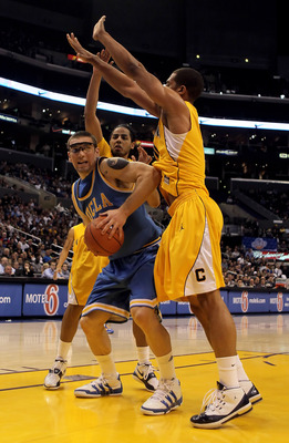 LOS ANGELES, CA - MARCH 12:  Reeves Nelson #11 of the UCLA Bruins is defended by Jorge Gutierrez (L) #2 and Jamal Boykin (R) #10 of the Cal Golden Bears in the second half during the Semifinals of the Pac-10 Basketball Tournament at Staples Center on Marc