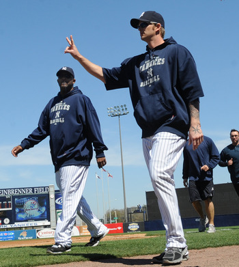 TAMPA, FL - MARCH 5: Pitchers A. J. Burnett #34 and CC Sabathia  #52 of the New York Yankees walk to the dugout before play  against the Tampa Bay Rays March 5, 2010 at the George M. Steinbrenner  Field in Tampa, Florida. (Photo by Al Messerschmidt/Getty