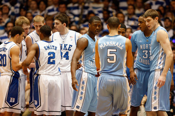 DURHAM, NC - FEBRUARY 09:  Harrison Barnes #40 and Tyler Zeller #44 of the North Carolina Tar Heels watch on against the Duke Blue Devils during their game at Cameron Indoor Stadium on February 9, 2011 in Durham, North Carolina.  (Photo by Streeter Lecka/