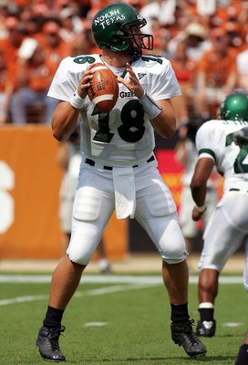 AUSTIN, TX - SEPTEMBER 2:  Quarterback Matt Phillips #18 of the North Texas Eagles drops back to pass against the Texas Longhorns on September 2, 2006 at Texas Memorial Stadium in Austin, Texas. The Longhorns defeated the Eagles 56-7.  (Photo by Ronald Ma