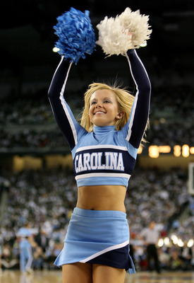DETROIT - APRIL 06:  A cheerleader for the North Carolina Tar Heels performs against the Michigan State Spartans during the 2009 NCAA Division I Men's Basketball National Championship game at Ford Field on April 6, 2009 in Detroit, Michigan.  (Photo by An