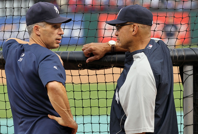 ARLINGTON, TX - OCTOBER 22:  Manager Joe Girardi of the New York Yankees talks with former Yankee and Hall of Famer Reggie Jackson during batting practice against the Texas Rangers in Game Six of the ALCS during the 2010 MLB Playoffs at Rangers Ballpark i